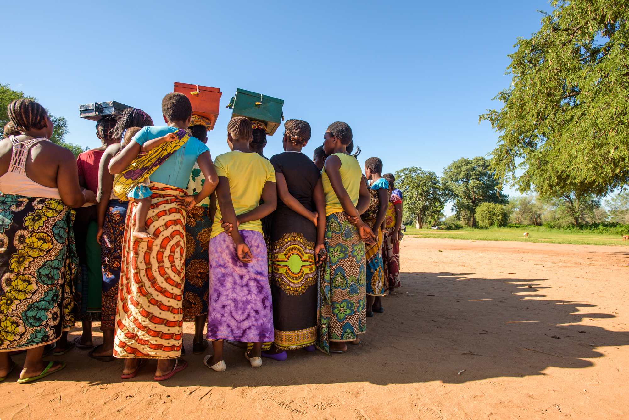 Savings group of women in circle in Zambia