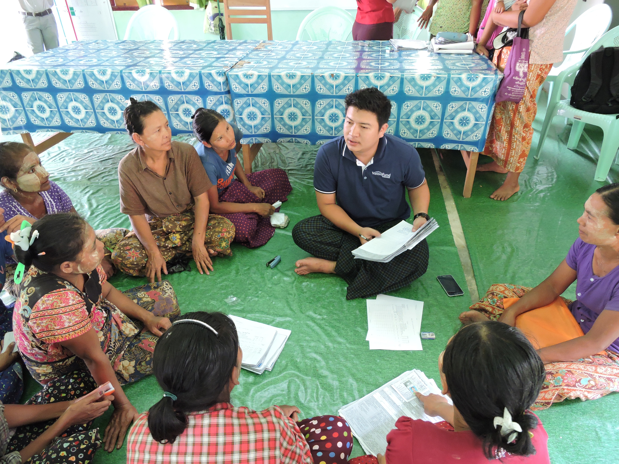 Savings group working with VisionFund staff member in Myanmar