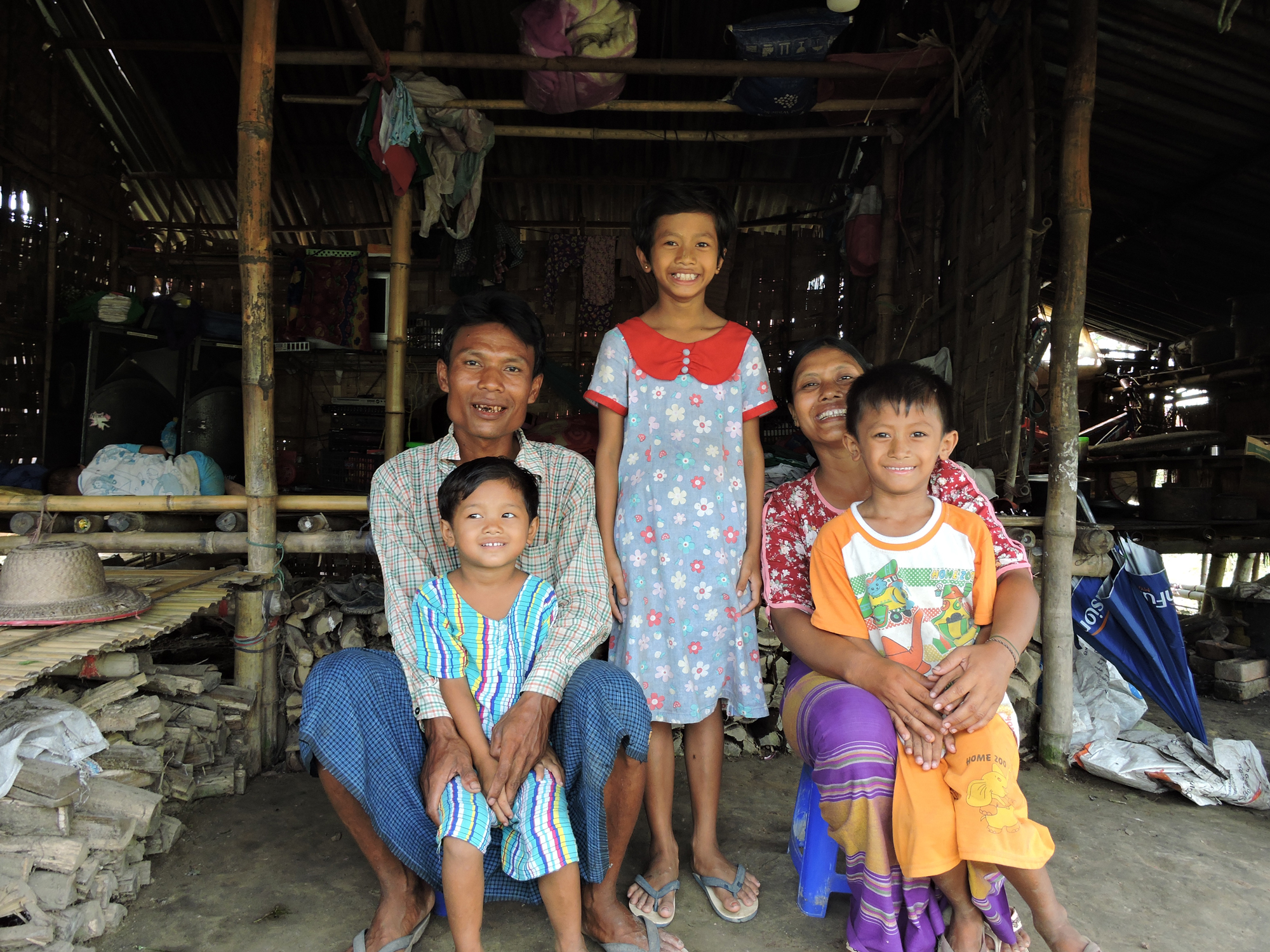 Family of five inside home in Myanmar
