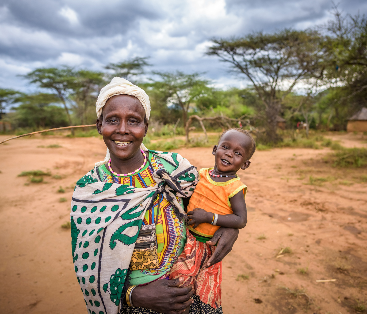 Mother holding child in rural Kenya