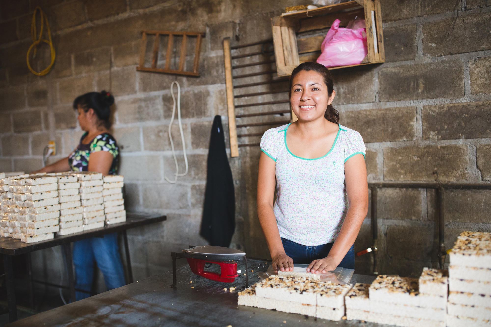 "VisionFund client making ""obleas"" candy that she sells in her community."