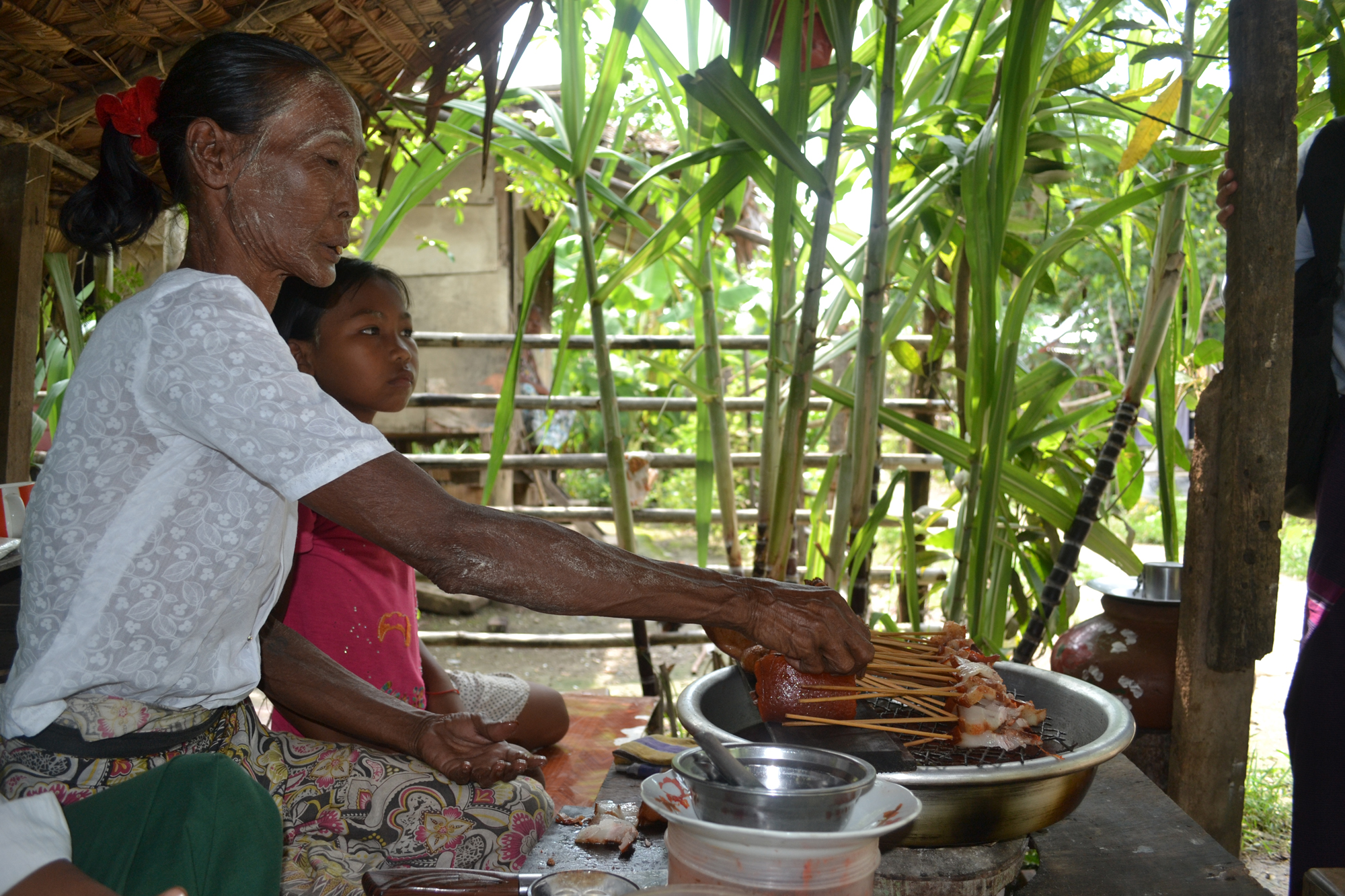 Daw Daw preparing food items she sells to make income