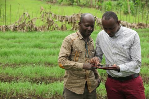 VisionFund loan officer collecting client data via tablet in Tanzania