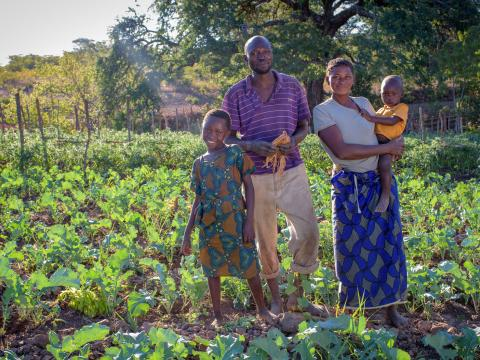 Family standing in farm in Zambia