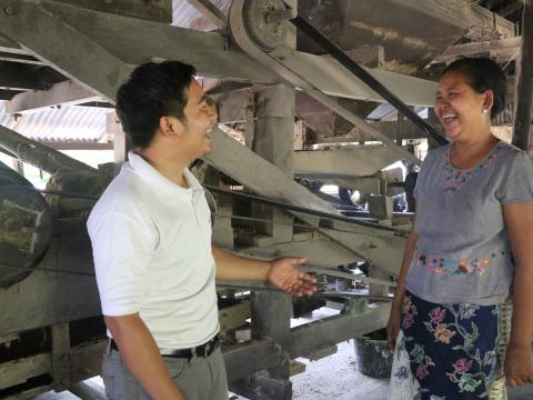 Daw San San standing infant of her mill in Myanmar
