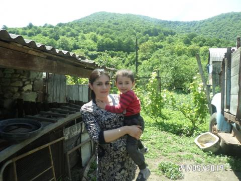Margarit and her three year old son on their farm in Armenia.