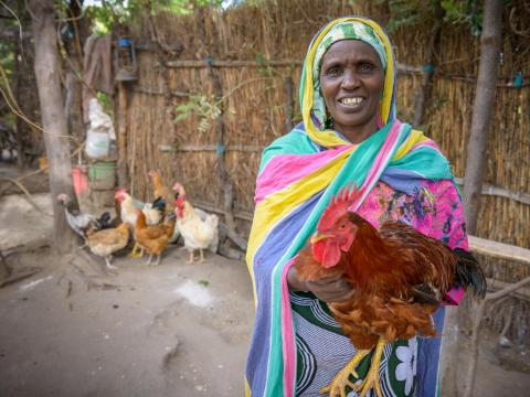 "The ""Wake up"" Savings group member that is raising chickens to provide for their families in Tanzania."