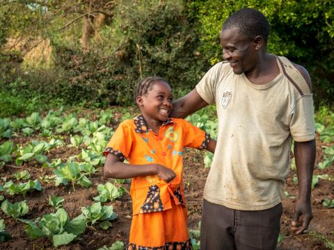father and his daughter on their farm in Zambia