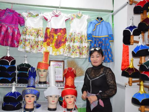 Ankhutya in her hat and clothing shop