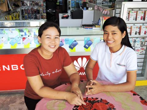 Myanmar staff with small business owner