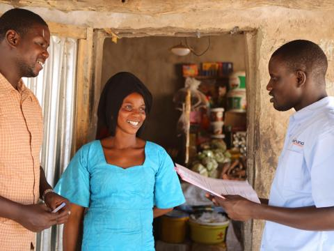 VisionFund staff in Senegal with a client