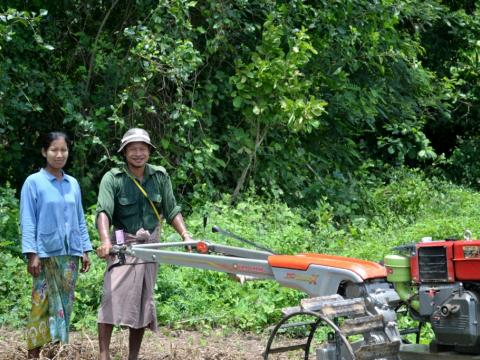 VF Myanmar client and husband working in the field