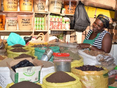 Pheona with her spice business at the Uganda marketplace