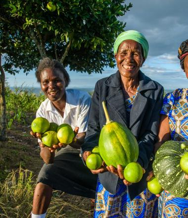 Group of women holding produce from their farm in Kenya