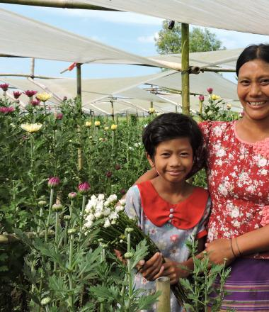 Mother and daughter in flower field in Myanmar