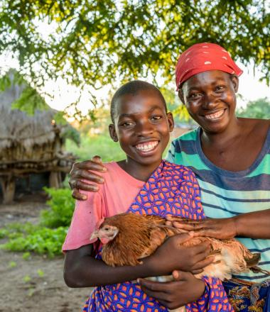 Mother and daughter with chicken