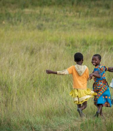 Girls running in rural Zambia