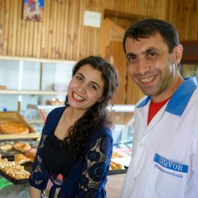 Husband and wife in bustling bakery in Armenia