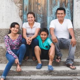 Family of four sitting on stairs in Dominican Republic