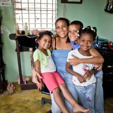 Mother with three children in her salon in Dominican Republic