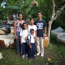 Family of six standing in front of home in Dominican Republic