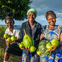 Women holding produce grown in their farm